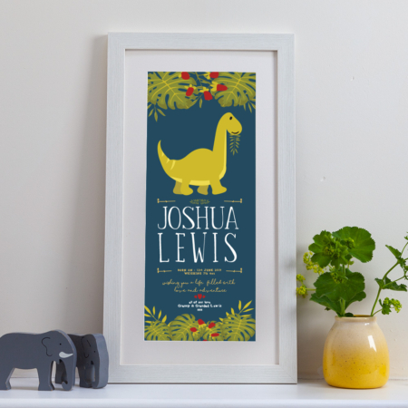 A tall framed personalised print with a happy dinosaur munching leaves on a rich blue background, ideal as a gift for a boy or girl